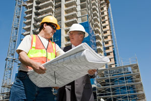 contractor and developer discussing a high rise construction project